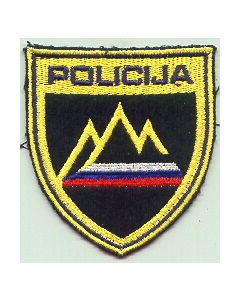A POLICE SLEEVE PATCH In Form Of A Shield