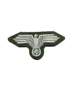 RSE100.Waffen SS officers sleeve eagle.Silver bullion and wire on Green. Each row of the wing is embroidered seperately with fine aluminum wire.  Our best broad wing eagle.