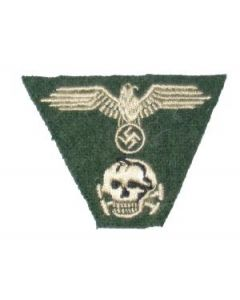 RSE597.Waffen SS embroidered M43 cap insignia on field gray.