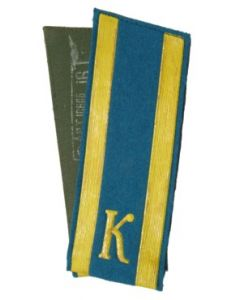 SSB9.Cadet.2 yellow stripes and the letter K on blue felt